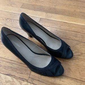 Naturalized black peep toe heels.